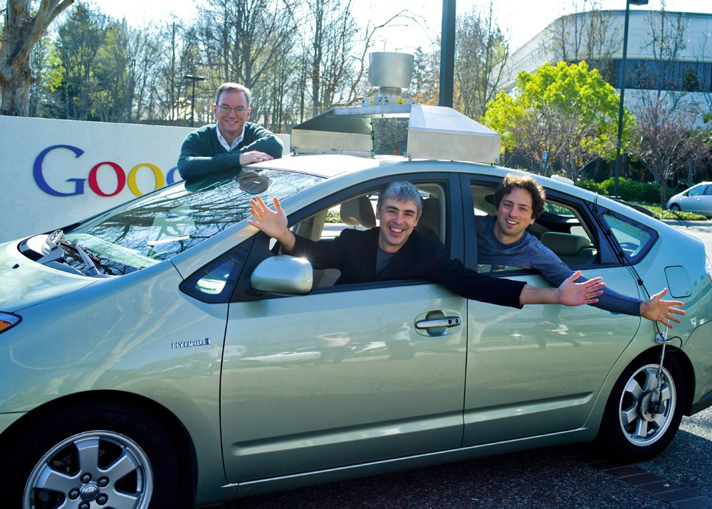 Google's self-driving car, with Schmidt, Page, and Brin
