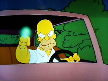Homer and some radioactive waste, in a car